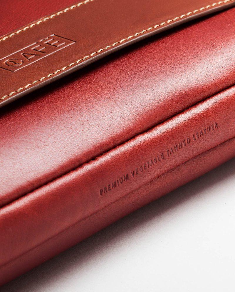 leather portfolio red bottom detail logo