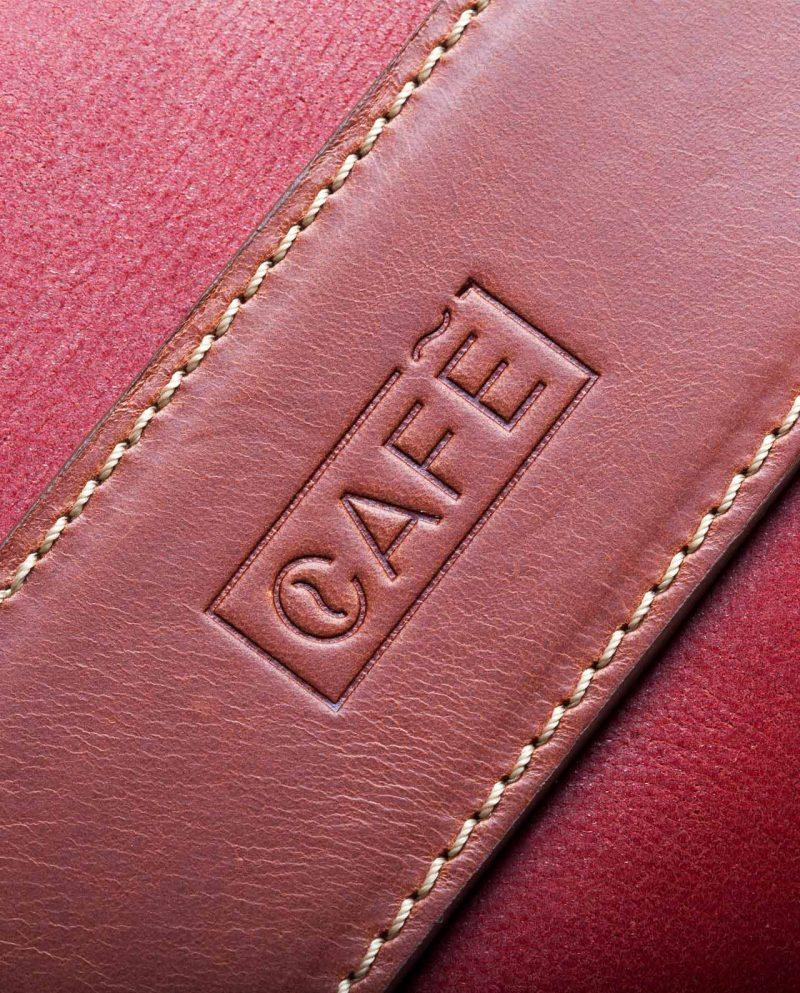 leather portfolio red logo detail