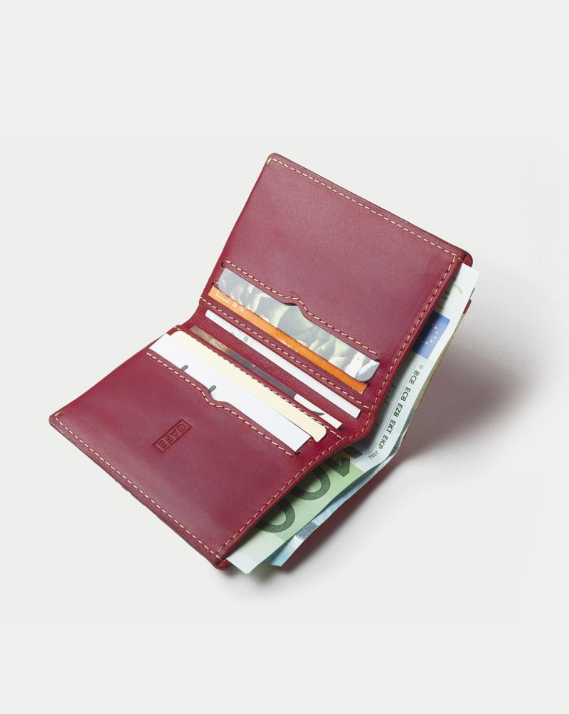 leather wallet red open bills