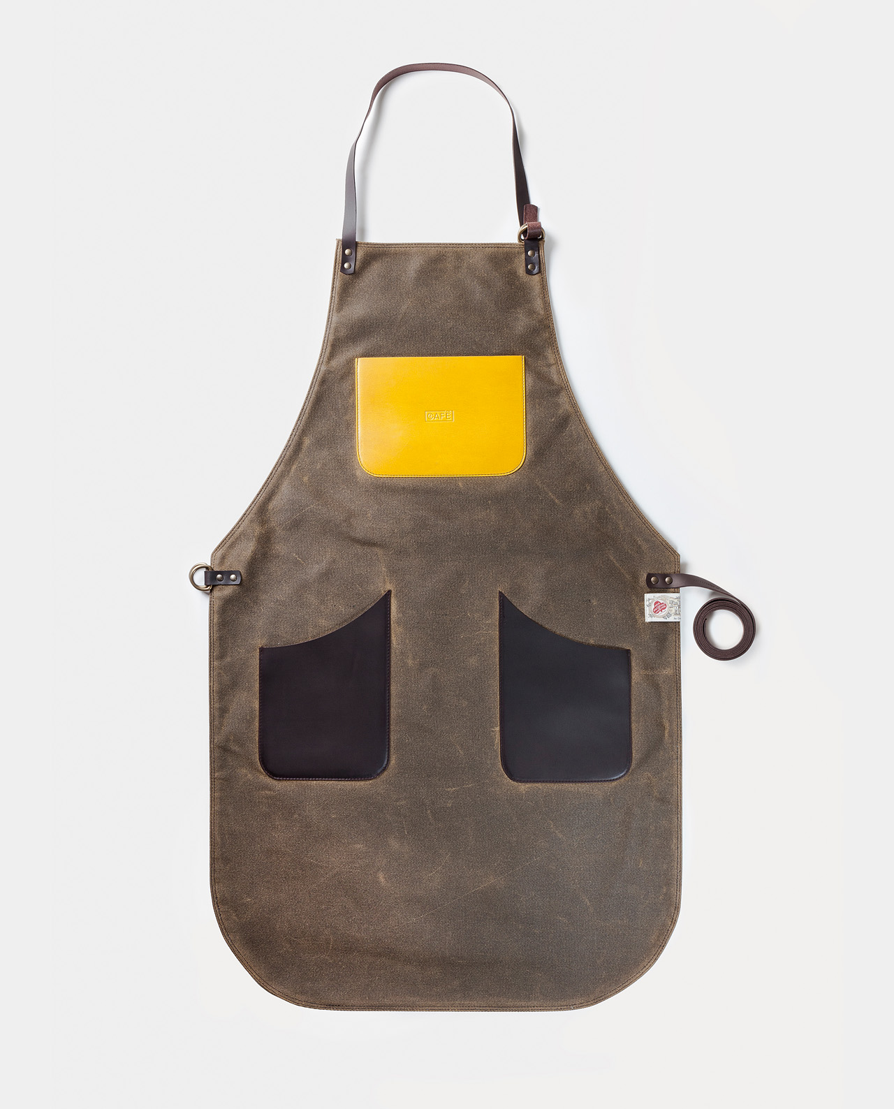 Delantal de trabajo Papúa. Works apron Papua. waxed canvas British Millerain and vegetable tanned leather.