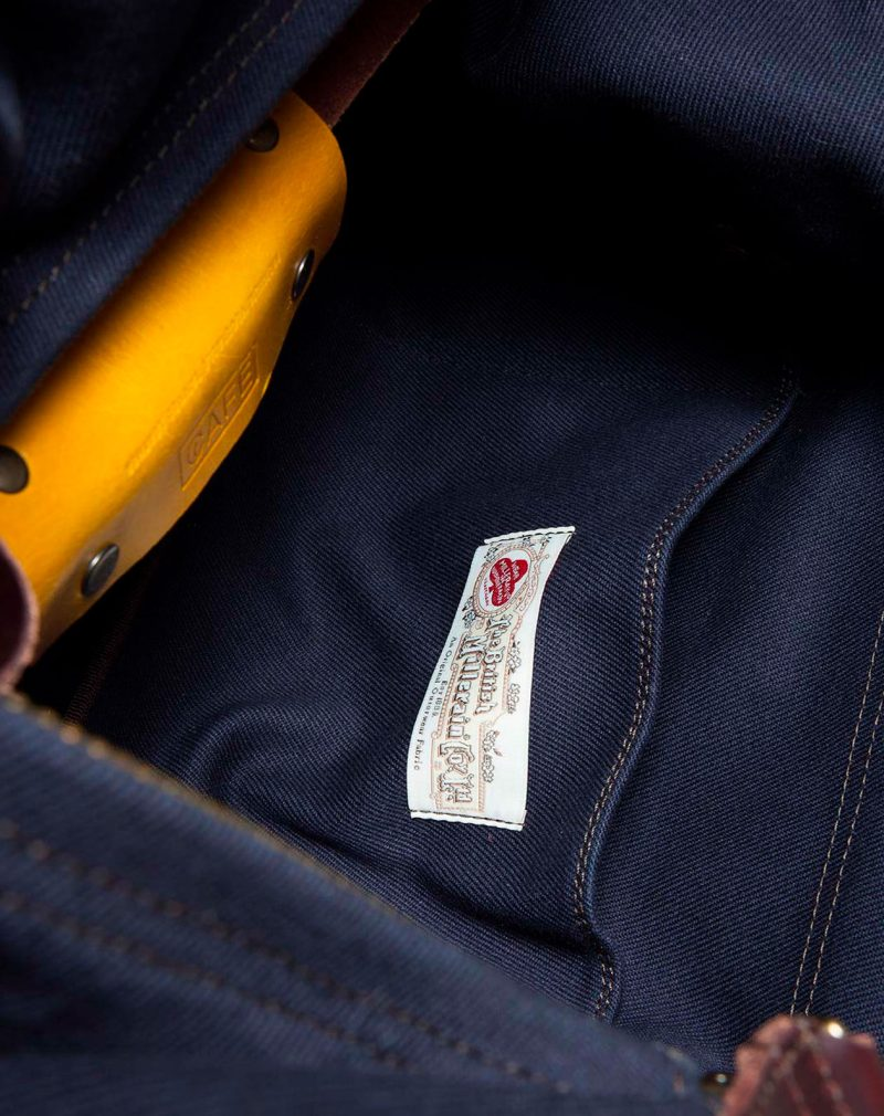 waxed canvas weekender navy tag detail