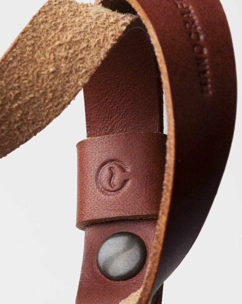 wrist camera strap logo leather detail