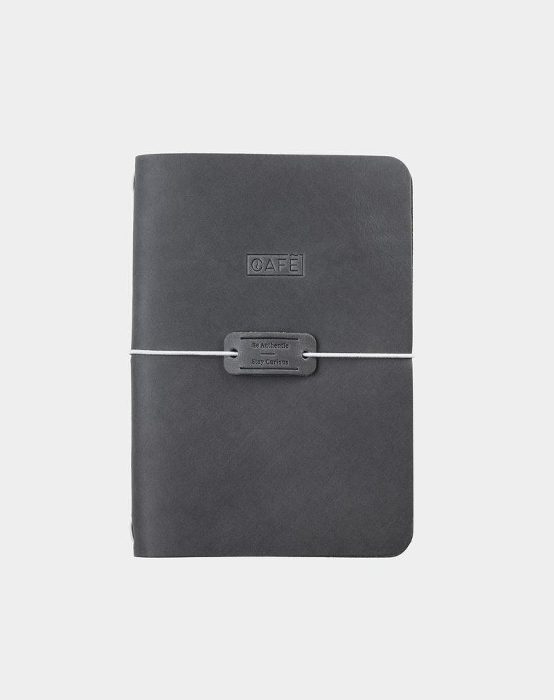 cuaderno de piel gris